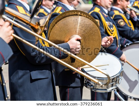 musicians of the military brass band plays the musical instruments - stock photo