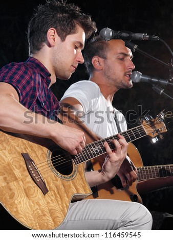 musicians playing guitars and singing,for music,entrainment themes - stock photo