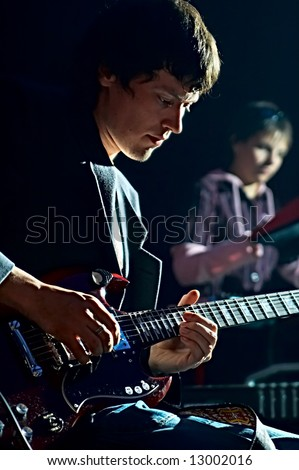 musicians playing in club on concerto - stock photo