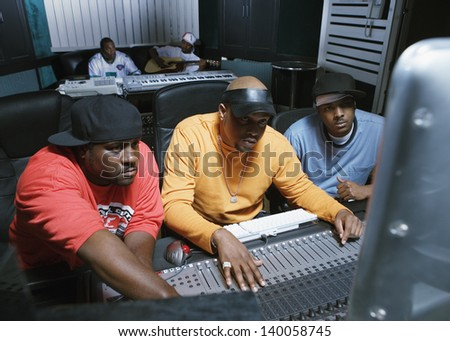 Musicians working on their music - stock photo