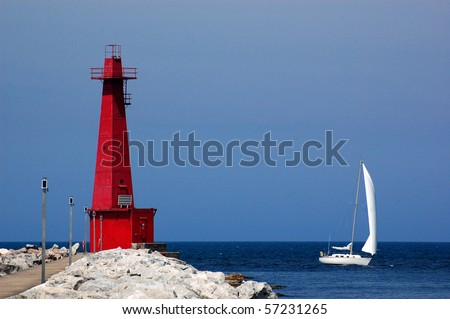Muskegon lighthouse and sailboat, lake Michigan, Muskegon, MI - stock photo