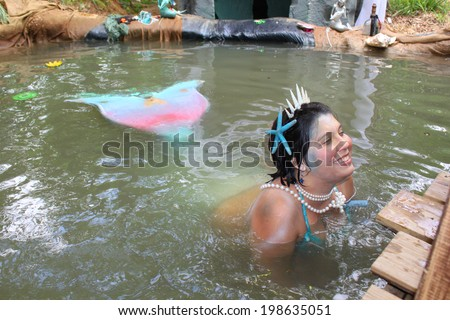 MUSKOGEE, OK - MAY 24: A mermaid greets children at the Oklahoma 19th annual Renaissance Festival on May 24, 2014 at the Castle of Muskogee in Muskogee, OK.