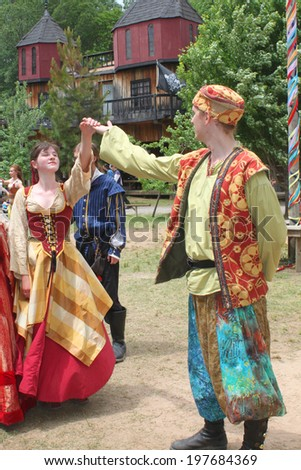 MUSKOGEE, OK - MAY 24: People in costumes dance at the Oklahoma 19th annual Renaissance Festival on May 24, 2014 at the Castle of Muskogee in Muskogee, OK.