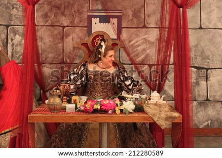 MUSKOGEE, OK - MAY 24: Queen greets her guests at the Queen's Tea party at the Oklahoma 19th annual Renaissance Festival on May 24, 2014 at the Castle of Muskogee in Muskogee, OK  - stock photo