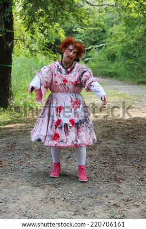MUSKOGEE, OK - Sept. 13: A bloody male zombie waits for the next runner to chase during the Castle Zombie Run at the Castle of Muskogee in Muskogee, OK on September 13, 2014.