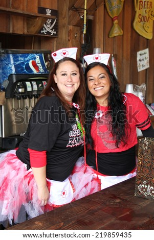 MUSKOGEE, OK - Sept. 13: Nurses serve drinks at the village during the Castle Zombie Run at the Castle of Muskogee in Muskogee, OK on September 13, 2014.  - stock photo