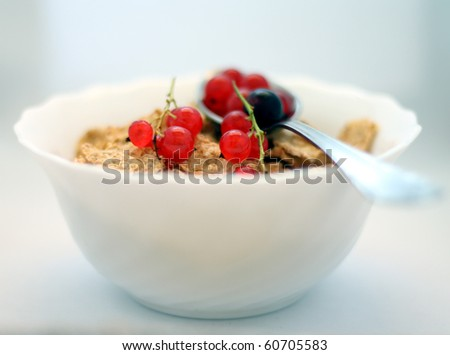 Musli breakfast in a bowl with spoon - stock photo