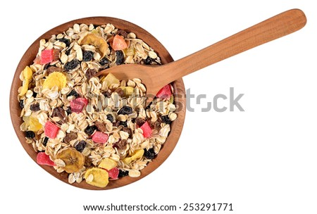 Musli in a wooden bowl on a white background