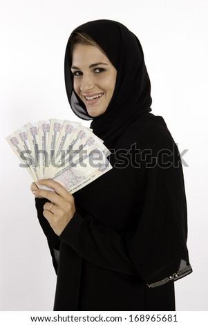 Muslim Arab Girl Wins Money In Dubai - stock photo