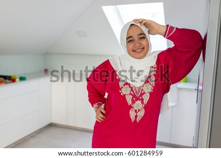 Muslim Arabian girl at home kitchen