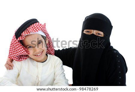 Muslim Arabic boy and girl with traditional clothes - stock photo