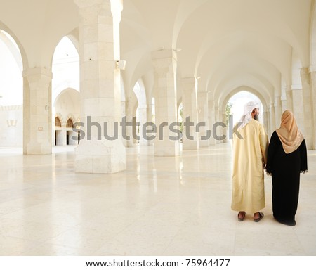 Muslim Arabic couple indoor, White mosque - stock photo