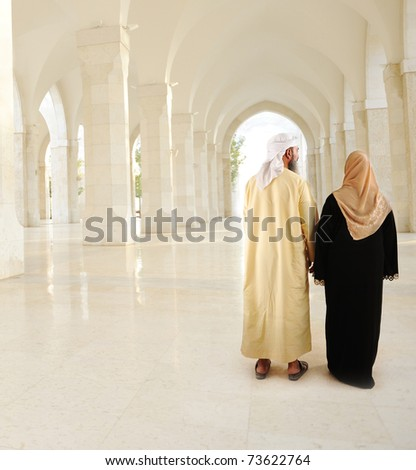 Muslim Arabic couple inside the modern mosque - stock photo