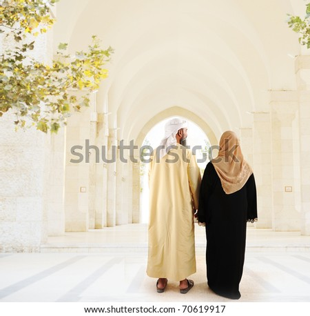 Muslim arabic couple walking together - stock photo