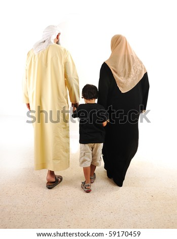 Muslim arabic family walking - stock photo