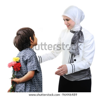 Muslim Arabic mother and son rose gift - stock photo