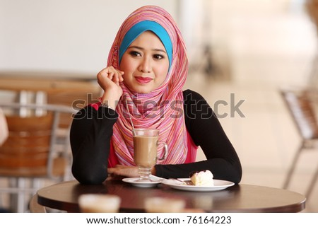 muslim asian girl at coffee table