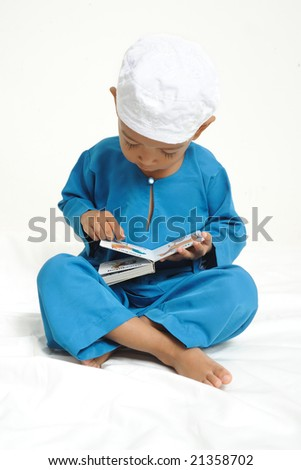 Muslim boy learning with Colorful book - stock photo