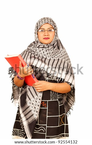 Muslim Caucasian female student with notebook and pen - stock photo