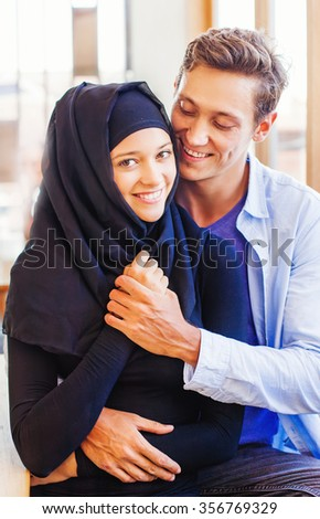 muslim couple in love at home - stock photo