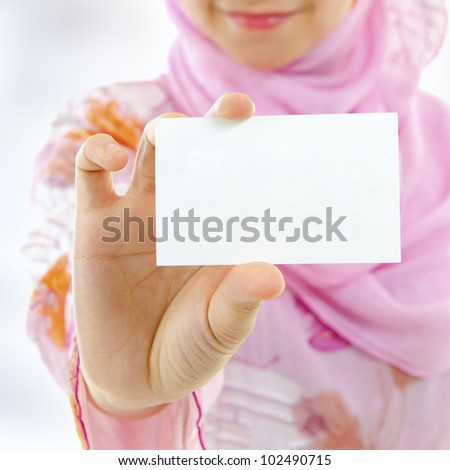 Muslim female holding business card, focus on hand - stock photo