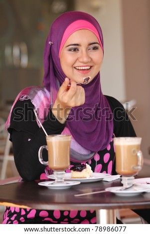 muslim girl at coffee table