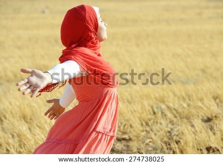 Muslim girl enjoying in nature - stock photo