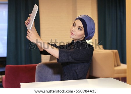 Muslim Girl Student Uses Tablet
