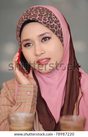 muslim girl was use red cellphone