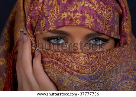 Muslim girl with beautiful blue eyes - stock photo