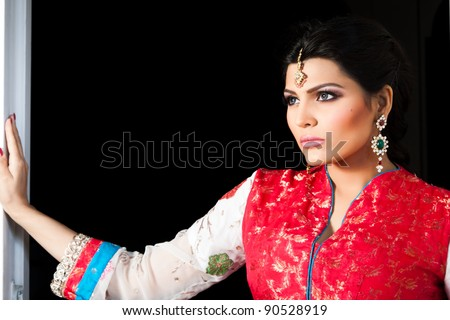 Muslim Indian bride wearing a red bridal dress, portrait of a beautiful Indian bride