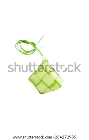 Muslim Ketupat (Rice Dumpling). Translation: Eid Mubarak - Blessed Feast Ketupats, a natural rice casing made from young coconut leaves for cooking rice on white background - stock photo