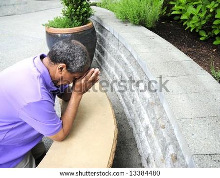 Muslim man praying outdoors. - stock photo