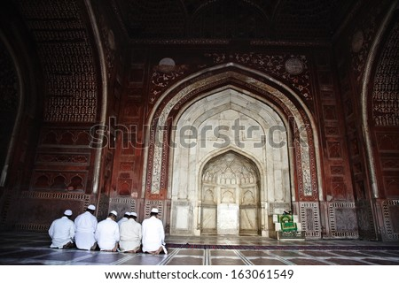 Muslim men praying in the mosque, Taj Mahal, Agra, Uttar Pradesh, India - stock photo