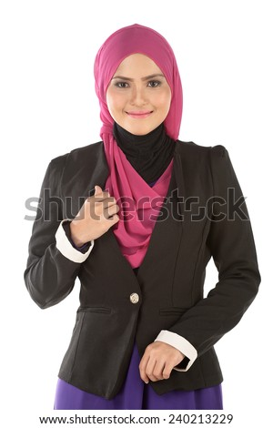 Muslim Modern Businesswoman Standing Against and looking at camera. - stock photo