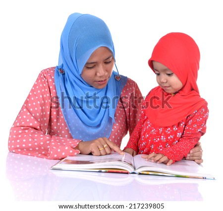 Muslim Mother and daughter looks in book. isolated white - stock photo