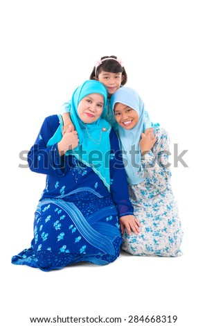 Muslim mother and daughters - stock photo
