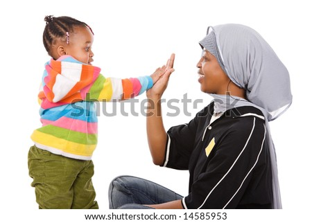 Muslim mother high five with her cute little African girl - stock photo