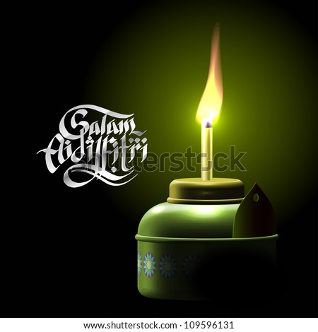 Muslim Oil Lamp - Pelita Translation of Malay Text: Greetings of Eid ul-Fitr, The Muslim Festival that Marks The End of Ramadan - stock photo