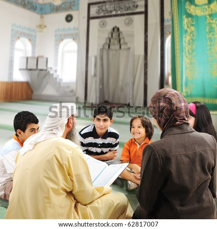 Muslim people teaching and learning inside the mosque, man, woman and children together reading Koran