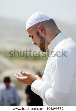 Muslim pilgrims praying on jabal Arafat, Hajj - stock photo