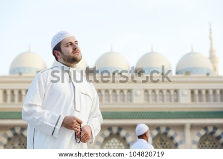 Muslim praying at Medina holy Islamic city - stock photo