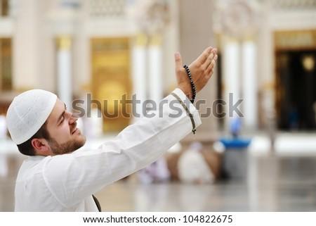 Muslim praying in Medina mosque outdoor - stock photo