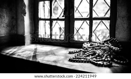 Muslim rosary beads on the mosque window, holy place of muslims. Islam prayer beads. Beads for praying - stock photo