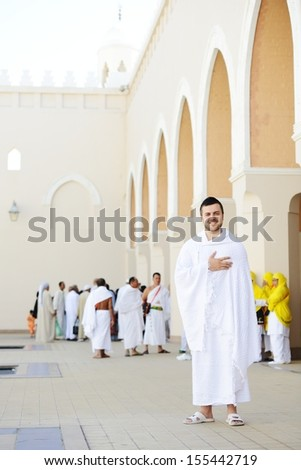Muslim standing at Meeqat for Hajj - stock photo