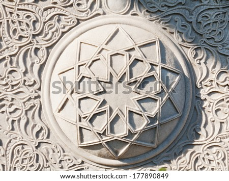 Muslim star on the wall of the mosque in Istanbul - stock photo