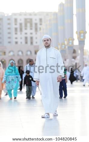 Muslim walking at holy Islamic places - stock photo