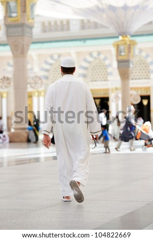 Muslim walking in Medina mosque outdoor - stock photo