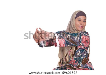 Muslim woman doing arm stretching exercise, isolated - stock photo