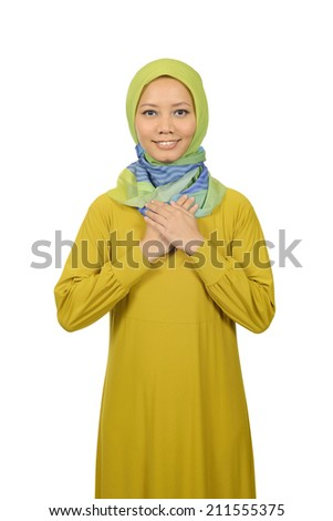 Muslim woman feel confident isolated over white background - stock photo